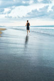 Fitness Man Running On Beach. Runner Jogging During Outdoor Workout Royalty Free Stock Images