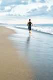 Fitness Man Running On Beach. Runner Jogging During Outdoor Workout Royalty Free Stock Photos