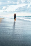Fitness Man Running On Beach. Runner Jogging During Outdoor Workout. Fitness. Fit Athletic Man Running On Beach. Jogger Exercising And Training For Marathon royalty free stock image