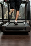 Fitness Man Running On Treadmill Stock Photo