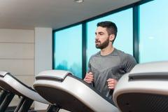 Fitness Man Running On Treadmill Stock Photos