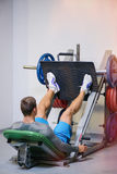 Fitness man shakes his legs. The concept of health, sports Royalty Free Stock Photography