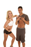 Fitness man show abs woman flex Stock Photography