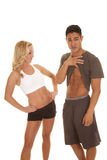 Fitness man show abs woman look Stock Photos