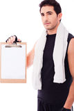 Fitness Man Showing A Blank Clip Board Royalty Free Stock Photography