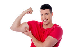 Fitness man showing bicep muscles Stock Photography