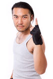 Fitness man showing number 1 hand gesture Stock Photo