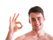 Fitness man showing Ok sign isolated Stock Image