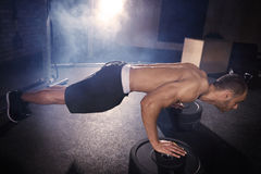 Fitness man. Side view of mid adult man in plank position Stock Photography