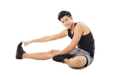 Fitness man sitting and making stretching Stock Photo