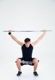 Fitness man squatting with barbell Royalty Free Stock Images