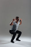 Fitness man squatting with expander Stock Image