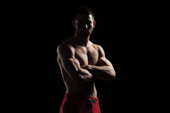 Fitness man standing with arms folded Royalty Free Stock Images