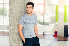 Fitness man standing in gym and looking away Royalty Free Stock Photo