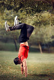 Fitness Man Standing in Hands Upside Down in Nature Stock Image