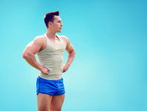 Fitness man stands in profile with a confident look in side Royalty Free Stock Image