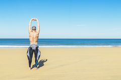 Fitness man swimmer training stretching Stock Photos