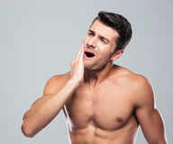 Fitness man with a toothache Royalty Free Stock Images