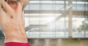 Fitness man Torso in a gym. Digital composite of Fitness man Torso in a gym Stock Images