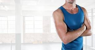Fitness man Torso in a gym. Digital composite of Fitness man Torso in a gym Stock Image