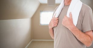 Fitness man Torso with towel in a cream room Royalty Free Stock Images