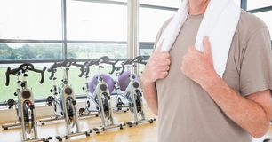 Fitness man Torso with a towel in a gym Stock Photos