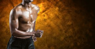 Fitness man torso who is running against dark background Stock Photo