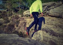 Fitness man trail runner running to rocky mountain top royalty free stock photography