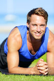 Fitness man training plank core exercise Stock Photo