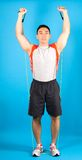 Fitness man use tubing to strengthen Stock Photo