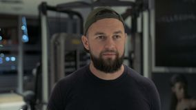 Fitness man walking in the gym. Camera stabilizer shot, slow motion stock video