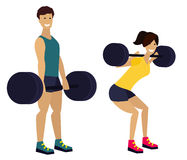 Fitness man and woman with barbell in gym Royalty Free Stock Image