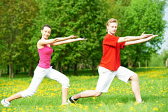 Fitness man and woman doing stretching exercises Royalty Free Stock Photo