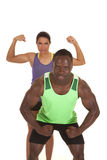 Fitness man and woman flex her behind Stock Photos