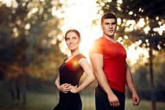Fitness Man and Woman Standing Outside in Nature stock images