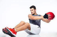 Fitness man working out with fitness ball Royalty Free Stock Photo
