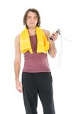 Fitness man with yellow towel and skipping rope Royalty Free Stock Photography
