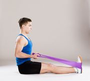 Fitness man. Young handsome man with perfect body in sport clothes Stock Photos
