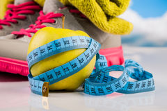 Fitness measure tape and healthy food Stock Photography