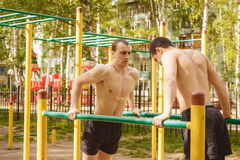 Fitness men at the bar. Exercising outdoors in the Park. Street workout. Fitness men at the bar. Exercising outdoors in the Park. Street workout stock photo