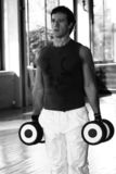 Fitness Men With Dumbbell. Expression of a Fitness Men Walking with Dumbbell / Dramatic Lights stock images
