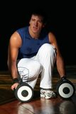 Fitness Men With Dumbbell. Expression of a Fitness Men / With Dumbbell / Shadows and Lights Royalty Free Stock Photography