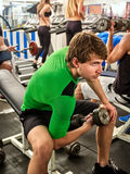 Fitness men friends in gym workout weights with equipment. Stock Photo