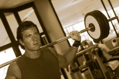 Fitness Men With Yoke. Expression of a Fitness Men / Squat with Yoke Royalty Free Stock Images