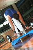 Fitness Men With Yoke. Exercise of a man in training with the balance / Folded in Ahead above the Step stock image