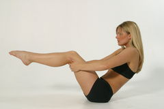 Fitness model 1-1a. Young blond woman exercising Royalty Free Stock Images