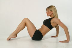 Fitness model. Young blond woman exercising Royalty Free Stock Photo