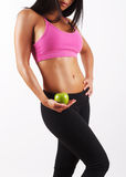 Fitness Model with an apple Stock Photography