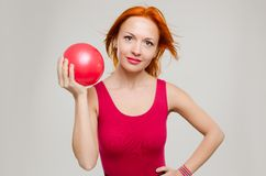 Fitness model with ball Stock Photography