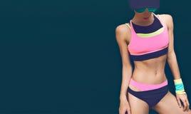 Fitness model on black background in fashion sportswear Royalty Free Stock Photo
